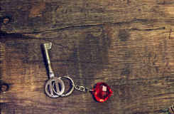 Old key with a keychain heart Stock Photo