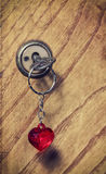 Old key with a keychain heart Stock Images