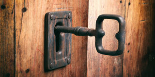 Old key in a keyhole. 3d illustration Stock Photos