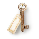 Old key with label Royalty Free Stock Photos