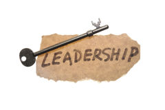 Old key and leadership word Stock Photos