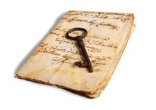 Old key on letter Stock Photos