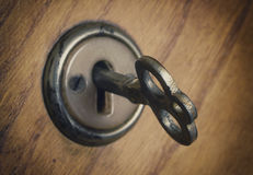 Old key in the lock Stock Photos