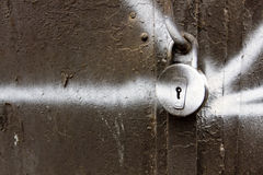 Old key lock on an old metal doors Royalty Free Stock Image