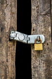 Old key lock on wooden door Stock Photo