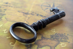Old key with map Royalty Free Stock Photo