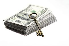 Old Key on Money Royalty Free Stock Photography