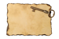 Old key on old paper Royalty Free Stock Photo