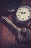 Old key with pocket watch,vintage filtered. Stock Image