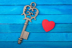 Old key and red heart Royalty Free Stock Image