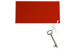Old key with red label. Closeup royalty free stock image