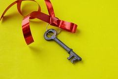 Old key with a red ribbon Stock Photography
