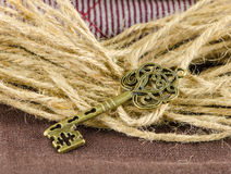 Old key and rope Stock Photo