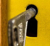 Old key is sitting in the door eye. Royalty Free Stock Image