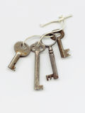Old Key String. Rustic keys on fraying loop of string. Isolated Stock Photography