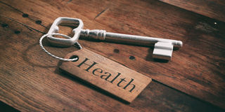 Old key with tag health on a wooden background. 3d illustration. Old metal key with label health on a wooden background. 3d illustration Stock Images