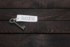 Key to success. Old key to success concept with label or tag Stock Image