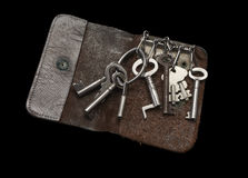 Old Key Wallet with old keys. Isolated on black background Stock Images