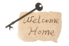 Old key and welcome home words Stock Photos