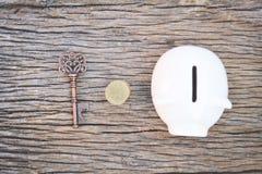 Old key on wood background Stock Photo