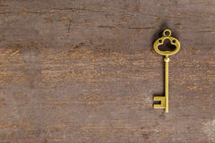 Old key on wood background Royalty Free Stock Images