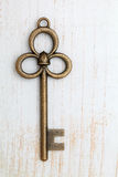 Old key on wood background Royalty Free Stock Photography