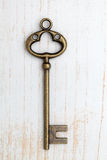 Old key on wood background Royalty Free Stock Photo