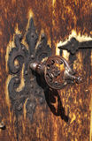 Old key in wooden door Royalty Free Stock Photo