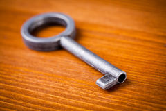 Old key on wooden table Royalty Free Stock Images