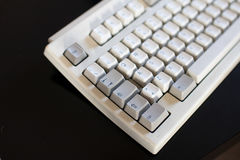 Old keyboard with mechanical buttons of ivory and gray color. Co. Mputer from 90s Stock Image