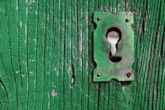 Old Keyhole. An old wood door with metal lock and keyhole Stock Image