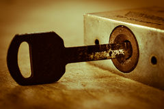 Old keyhole with key Stock Photography