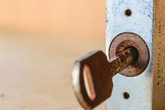 Old keyhole with key Royalty Free Stock Photo