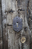 Old Keyhole in Wooden Door Royalty Free Stock Photo