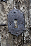 Old Keyhole in Wooden Door. Old Rusty Keyhole in Traditional Wooden Door Stock Photography