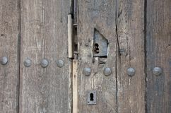 Old keyhole on wooden door royalty free stock photography