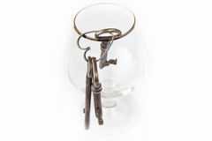 Old keys. Three old keys in a glass Stock Images