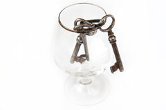 Old keys. Three old keys in a glass Royalty Free Stock Photography