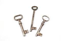 Old keys. Three isolated old keys on a white background Royalty Free Stock Image