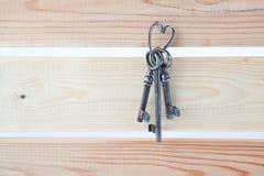 Old keys. Three old keys on a wooden wall Stock Photo