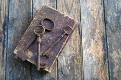 Old keys. On a old book, antique wood background Stock Image