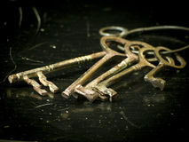 Old Keys on dark grunge background Stock Images