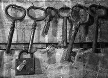 Old keys hang next to the lock Royalty Free Stock Photo