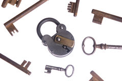 Old keys and lock. An Old lock with an assortment of keys....unlocking the past Royalty Free Stock Photos