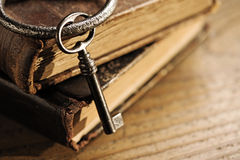 Old keys on a old book. Antique wood background Royalty Free Stock Images