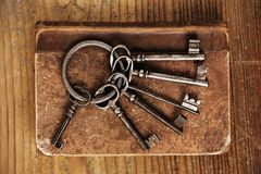 Old keys on a old book Royalty Free Stock Photo