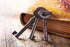 Old keys with old book Stock Photos