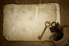 Old keys on old paper background Royalty Free Stock Images
