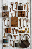 Old keys and padlocks. Backgrounds timber structure Royalty Free Stock Photo