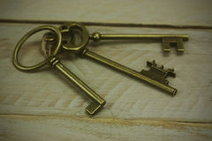 Old keys on a rustic background Royalty Free Stock Photos